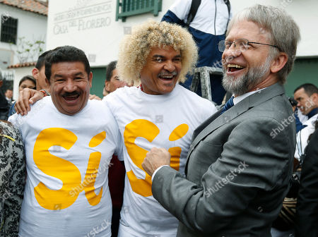 Carlos Valderrama, Miguel Lora, Antanas Mockus Former soccer star Carlos Valderrama, center, former boxer Miguel Lora, left, and former presidential candidate Antanas Mockus, right, laugh during an event organized by supporters of a peace deal with the Revolutionary Armed Forces of Colombia, FARC, in Bogota, Colombia, . Colombians will vote in a national referendum on the accord deal to end more than 50 years of conflict between Colombia's government and the country's largest rebel group on Oct. 2
