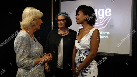 Stock Photo of Camilla, Duchess of Cornwall, left, meets domestic violence victim Meanie Clarke, right, and Sandra Horley, the CEO of the charity Refuge, Britain's largest charity dealing with domestic violence, during a visit in London