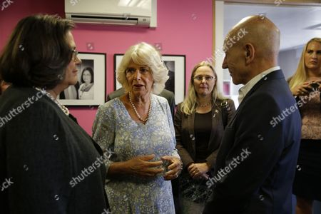 Camilla Duchess of Cornwall, talks to Sandra Horley, left, the CEO of the charity Refuge, and Sir Patrick Stewart