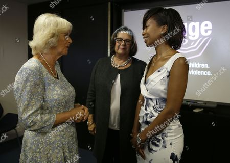 Stock Image of Camilla Duchess of Cornwall, left, meets domestic violence victim Melanie Clarke, right, and Sandra Horley the CEO of the charity Refuge