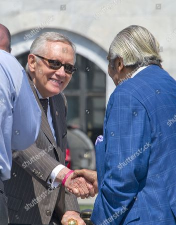 United States Senate Minority Leader Harry Reid (Democrat of Nevada) shakes hands with US Representative Charles Rangel (Democrat of New York)