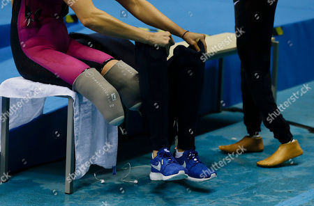 Jessica Long United States' Jessica Long puts on her prosthetic legs after competing in the women's 400-meter freestyle S8 final swimming event at the Paralympic Games in Rio de Janeiro, Brazil