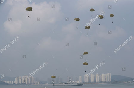 Stock Image of South Korean soldiers parachute down at the 66th Incheon Landing Operations Commemoration ceremony in waters off Incheon, South Korea, . Incheon is the coastal city where the United Nations Forces led by U.S. General Douglas MacArthur landed in September, 1950 just months after North Korea invaded the South. North Korea on Friday conducted its fifth atomic test, producing its biggest-ever explosive yield, South Korean officials said after monitors detected unusual seismic activity near the North's northeastern nuclear test site