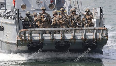 "South Korea and U.S. Marines on a boat, land on the shore during the 66th Incheon Landing Operations Commemoration ceremony in waters off Incheon, South Korea, . Incheon is the coastal city where the United Nations Forces led by U.S. General Douglas MacArthur landed in September, 1950 just months after North Korea invaded the South. North Korea said Friday it conducted a ""higher level"" nuclear warhead test explosion, which it trumpeted as finally allowing it to build ""at will"" an array of stronger, smaller and lighter nuclear weapons. It is Pyongyang's fifth atomic test and the second in eight months"