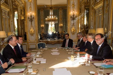 French President Francois Hollande (1st R), flanked by French Minister of Foreign Affairs Jean-Marc Ayrault (2nd R) and Former French Minister for Foreign Affairs Bernard Kouchner (3rd R), speaks during a meeting with Iraqi Kurdish Regional President Massoud Barzani (2nd L) during their meeting at the Elysee presidential palace