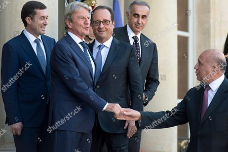 French President Francois Hollande and Former French Minister for Foreign Affairs Bernard Kouchner as he arrives at the Elysee Palace