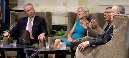 Former Kansas Governors, from left, Bill Graves, Kathleen Sebelius, Mike Hayden and John Carlin talk in support of retaining Kansas Supreme Court justices in November's election during an event, in Kansas City, Mo. The former Governors hope to blunt Republican complaints over the seven-justice court's rulings on public school funding and decisions reversing death sentences in capital murder cases