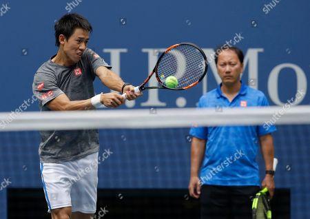 Kei Nishikori, Michael Chang Kei Nishikori, of Japan, returns a shot as coach Michael Chang looks on while practicing before playing in the semifinals of the U.S. Open tennis tournament, in New York