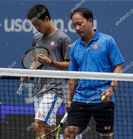 Kei Nishikori, Michael Chang Kei Nishikori, of Japan, left, walks of the court with coach Michael Chang after practicing before playing in the semifinals of the U.S. Open tennis tournament, in New York