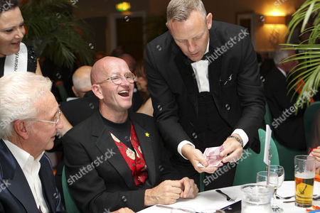 Magician Paul Martin wows Eddie Edwards with some table magic