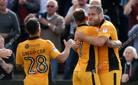 Stock Image of Jonathan Parkin of Newport County celebrates scoring a goal with Sean Rigg.