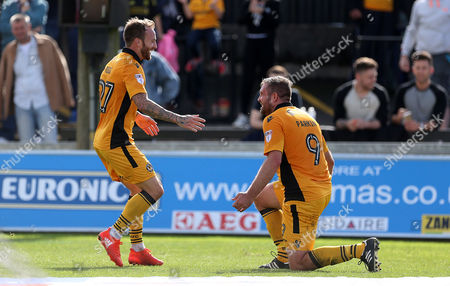 Jonathan Parkin of Newport County celebrates scoring a goal with team mate Sean Rigg.