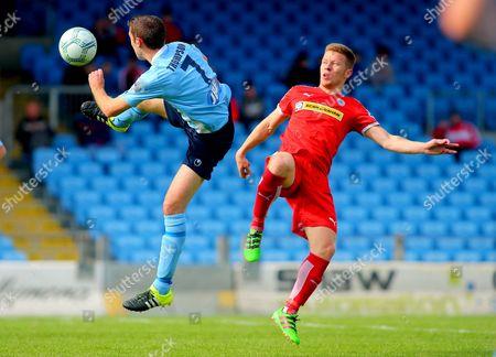 Ballymena United vs Cliftonville. Ballymena's Gary Thompson and Stephen Garrett of Cliftonville