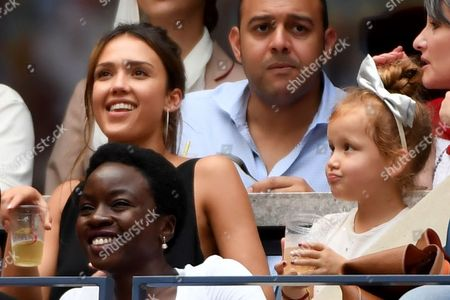 Stock Photo of Jessica Alba with her daughter Haven Garner Warren enjoy the tennis, watching Angelique Kerber face Karolina Pliskova in the Women's Singles Final of the US Open 2016 at the Billie Jean King National Tennis Centre, Queens, New York on the 10th September 2016