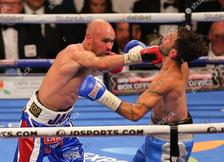 Stock Image of Lee Haskins and Stuart Hall   fight  at  The O2 Arena , Peninsula Square London  on 10th September 2016
