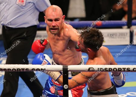 Stock Picture of Lee Haskins and Stuart Hall   fight  at  The O2 Arena , Peninsula Square London  on 10th September 2016