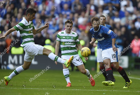 Rangers Niko Kranjcar (19) passes the ball with Celtic's Nir Bitton and James Forrest closing in