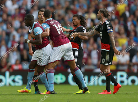 Nottingham Forest's Hildeberto Pereira tussles with Aston Villa's Aly Cissokho for his first booking during the Sky Bet Championship match between  Aston Villa and Nottingham Forest played at Villa Park, Nottingham on 11th September 2016