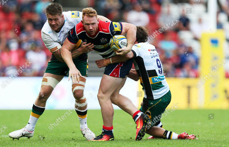 Will Hurrell of Bristol Rugby is tackled by Teimana Harrison and Lee Dickson of Northampton Saints during the Aviva Premiership match between Bristol Rugby and Northampton Saints played at Ashton Gate Stadium, Bristol on 11th September 2016