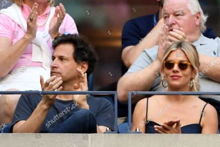 Director Bennett Miller and actress Sienna Miller applaud Stan Wawrinka and Novak Djokovic in the Men's Final in the US Open 2016 at the Billie Jean King National Tennis Centre, Queens, New York on the 11th September 2016