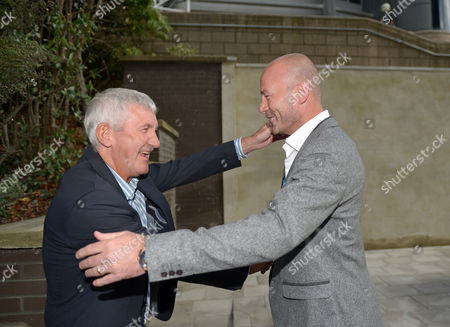 Terry McDermott (left) greets Alan Shearer during the unveiling of the Alan Shearer statue at St. James' Park, Newcastle upon Tyne on 12th September 2016
