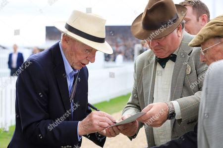 John Surtees signing autographs.