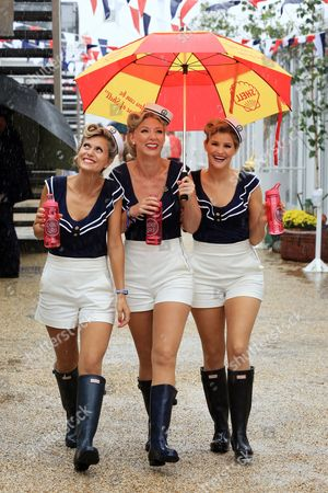 Stock Picture of The Dolly Girls: Hannah Woolley, Helen Patching, Katy Osborne, dressed in vintage sailor outfits during the wet weather