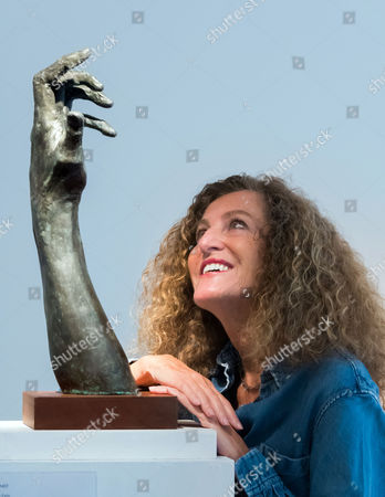 Nicole Farhi with 'Violinist' sculpture (of Anthony Marwood)