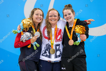 Stock Photo of Susannah Rodgers of Great Britain (C) wins Gold and Nikita Howarth of New Zealand (R) wins Bronze in the Women's 50m Butterfly S7 Final.