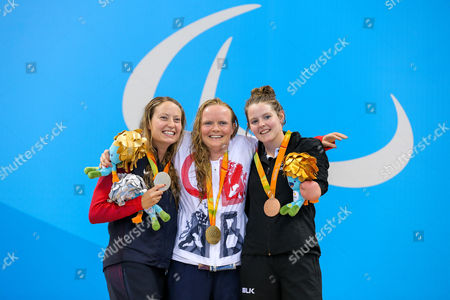 Stock Image of Susannah Rodgers of Great Britain (C) wins Gold and Nikita Howarth of New Zealand (R) wins Bronze in the Women's 50m Butterfly S7 Final.