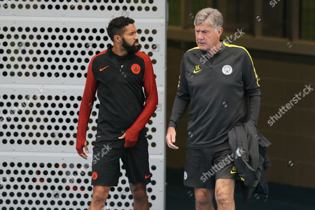 Gael Clichy of Manchester City and Brian Kidd training ahead of their UEFA Champions League match against Borussia Monchengladbach held at the Manchester City Academy, Manchester on September 12th 2016