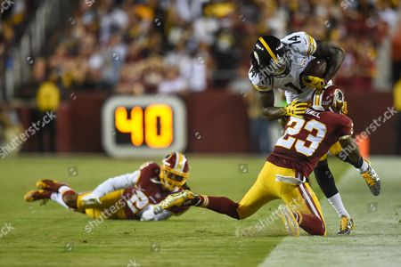 Washington Redskins strong safety DeAngelo Hall (23) tackles Pittsburgh Steelers wide receiver Sammie Coates (14) out of bounds during the season opening matchup