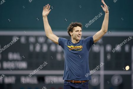 "Stock Image of Grayson Powell Actor Grayson Powell, who plays the part of bartender Sam Malone in ""Cheers Live on Stage,"" gestures to the crowd at Fenway Park before a baseball game between the Boston Red Sox and the Baltimore Orioles, in Boston"