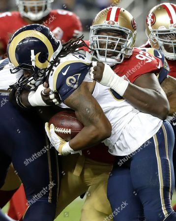Quinton Dial, Todd Gurley San Francisco 49ers defensive end Quinton Dial (92) tackles Los Angeles Rams running back Todd Gurley during the first half of an NFL football game in Santa Clara, Calif
