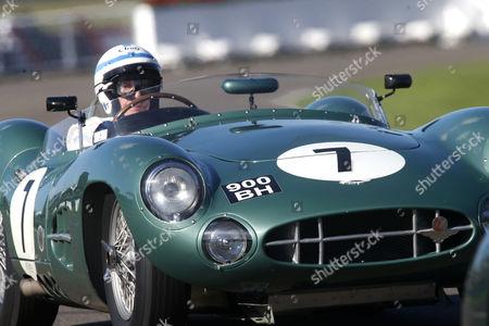 John Surtees driving an Aston Martin.