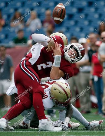 Isaac Yiadom, Ross Comis Massachusetts quarterback Ross Comis (2) fumbles the ball as he is hit by Boston College defensive back Isaac Yiadom, bottom right, during the second quarter of an NCAA college football game in Foxborough, Mass., Saturday, Sept.10, 2016