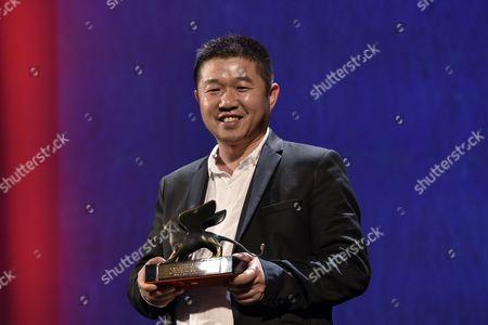 Stock Image of The Orizzonti Award for Best Screenplay to Ku Qian (Bitter Money) by Wang Bing