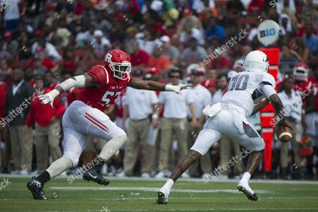 Rutgers Scarlet Knights defensive lineman Julian Pinnix-Odrick (53) pursues Howard Bison quarterback Jason Collins (10)