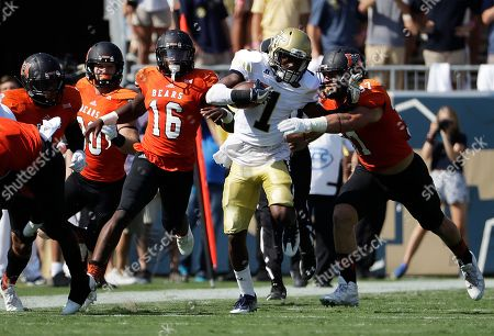 Stock Picture of Qua Searcy, Tyler Ward Georgia Tech's Qua Searcy (1) runs the ball against the defense of Mercer's Tyler Ward in the first half of an NCAA college football game in Atlanta