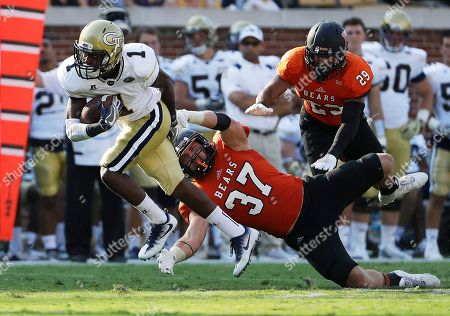 Stock Photo of Qua Searcy, Tyler Ward Georgia Tech's Qua Searcy (1) runs the ball against Mercer's Tyler Ward in the second half of an NCAA college football game in Atlanta