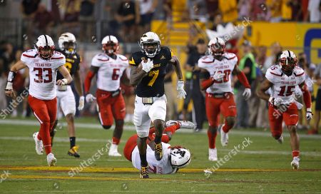 Stock Image of Arizona State's Kalen Ballage (7) runs past Texas Tech defenders Brayden Stringer (33), Kris Williams (6), Jordyn Brooks, second from right, Keenon Ward (15), Jah'Shawn Johnson, middle on the ground, as Ballage runs for his eighth touchdown during the second half of an NCAA college football game, in Tempe, Ariz. Arizona State defeated Texas Tech 68-55
