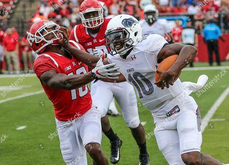 Howard Bison quarterback Jason Collins (10) delivers a stiff arm on Rutgers Scarlet Knights defensive back Damon Hayes (18)