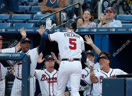 Stock Photo of Freddie Freeman, Brian Snitker, Terry Pendleton Atlanta Braves' Freddie Freeman (5) is greeted at the dugout by interim manager Brian Snitker, right, and bench coach Terry Pendleton, left, after hitting a two-run home run in the first inning of a baseball game against the Miami Marlins, in Atlanta