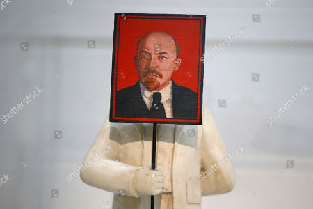 """""""Loup-garou (Bureaucrate au portrait de Lenine) 1984-1985"""" by Grisha Bruskin (1945) is displayed as part of the presentation of the Kollektsia exhibition dedicated to Russian contemporary art at Beaubourg Museum in Paris, France. One of the richest oligarchs in Russia, Vladimir Potanin, is donating over 250 works of Russian and Soviet art to France national modern art museum, the Pompidou Center, to promote cultural understanding. The exhibition runs through Sept. 14, 2016 to March 27, 2017"""