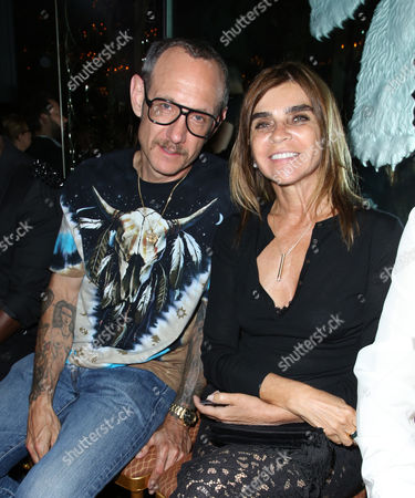 Terry Richardson and Carine Restoin-Roitfeld in the front row