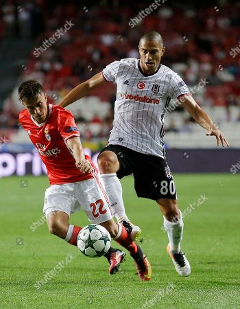 Gokhan Inler, Franco Cervi Besiktas' Gokhan Inler, right, tries to stop Benfica's Franco Cervi during the Champions League group B soccer match between Benfica and Besiktas at the Luz stadium in Lisbon