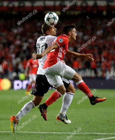 Gokhan Inler, Franco Cervi Besiktas' Gokhan Inler, left, and Benfica's Franco Cervi jump for the ball during the Champions League group B soccer match between Benfica and Besiktas at the Luz stadium in Lisbon