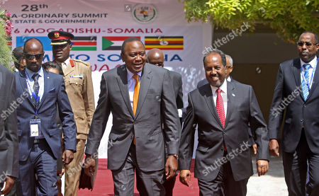 Hassan Sheikh Mohamud, Uhuru Kenyatta Kenya's President Uhuru Kenyatta, center left, and Somalia's President Hassan Sheikh Mohamud, center right, walk together during the regional Intergovernmental Authority on Development (IGAD) summit at the Peace Hotel in Mogadishu, Somalia . Somalia on Tuesday hosted its first regional summit of African heads of state in 30 years, a source of pride in this Horn of Africa country after decades of chaos and deadly attacks by al-Shabab extremists