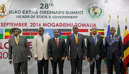 Yoweri Museveni, Hailemariam Desalegn, Hassan Sheikh Mohamud, Uhuru Kenyatta, Mahamoud Ali Youssouf, Mohamed Yusuf Osman From left, Uganda's President Yoweri Museveni, Ethiopia's Prime Minister Hailemariam Desalegn, Somalia's President Hassan Sheikh Mohamud, Kenya's President Uhuru Kenyatta, Djibouti's Foreign Minister Mahamoud Ali Youssouf, and Sudan's Ambassador to Somalia Mohamed Yusuf Osman, pose for a group photograph during the regional Intergovernmental Authority on Development (IGAD) summit at the Peace Hotel in Mogadishu, Somalia . Somalia on Tuesday hosted its first regional summit of African heads of state in 30 years, a source of pride in this Horn of Africa country after decades of chaos and deadly attacks by al-Shabab extremists