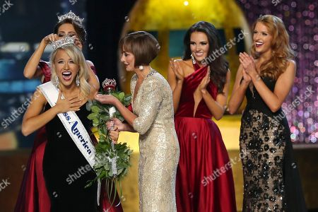 Betty Cantrell, Savvy Shields, Lynn Weidner, Hannah Brewer, Caroline Carothers The outgoing Miss America, Betty Cantrell, back left, crowns the Miss America winner Miss Arkansas Savvy Shields, while Lynn Weidner, third right, assists, as Miss Maryland Hannah Brewer, second right, and Miss Texas 2016 Caroline Carothers, look on during the Miss America 2017 pageant, in Atlantic City, N.J